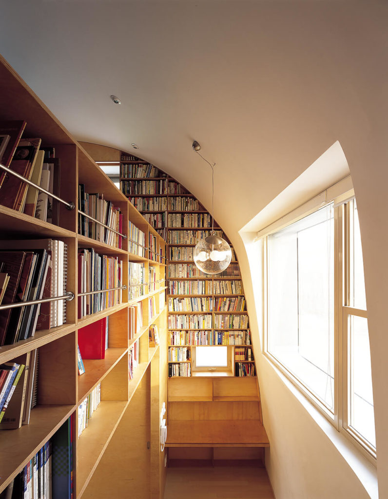 The interior comprises a large open, interconnected space that sprawls both horizontally and vertically. A massive library's worth of shelving covers the walls, transforming the look of the interior.