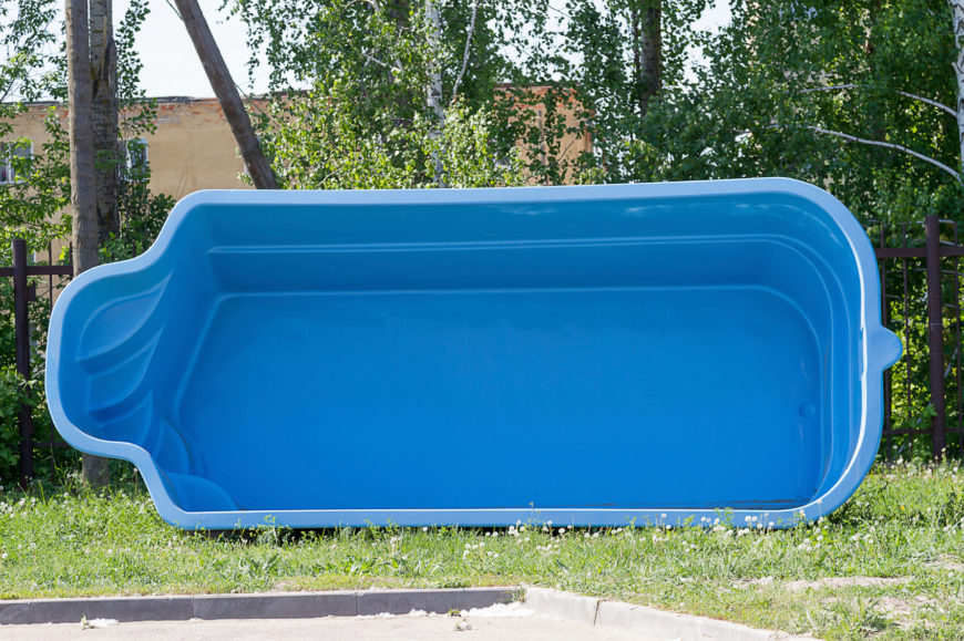 The Blue Plastic Swimming Pool On Side Of Form