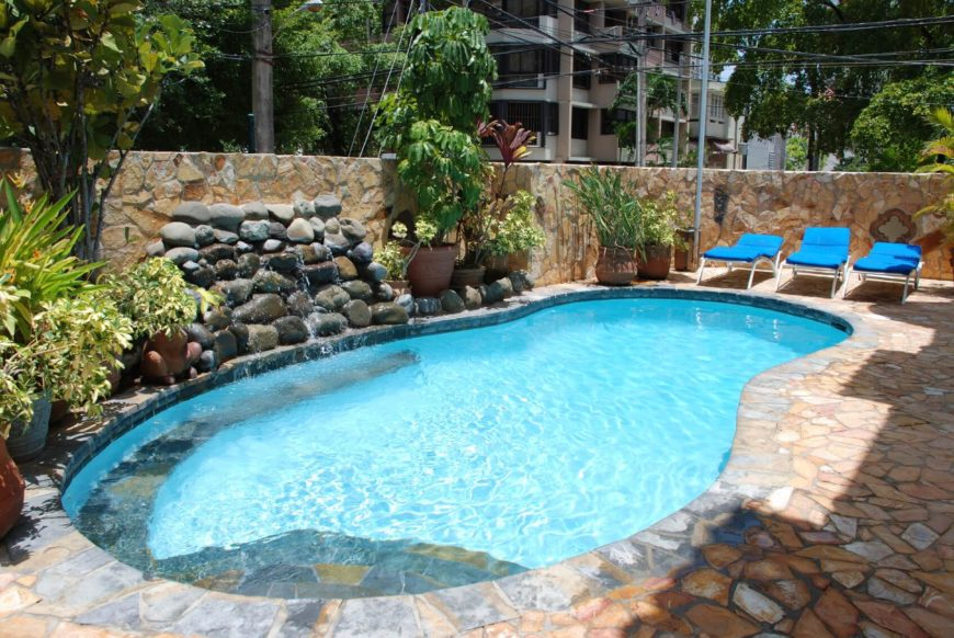 Backyard Pool Desigs backyard pool ideas 15 amazing backyard pool ideas home design lover style Tropical Pool