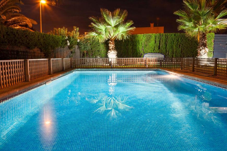 Pool Fence Ideas pool fence A Simple Wood Lattice Short Fence Provides A Nice Simple And Safe Option