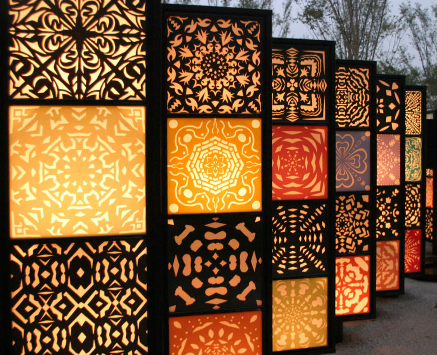 A design and some lighting can make screens light up your outdoor space.