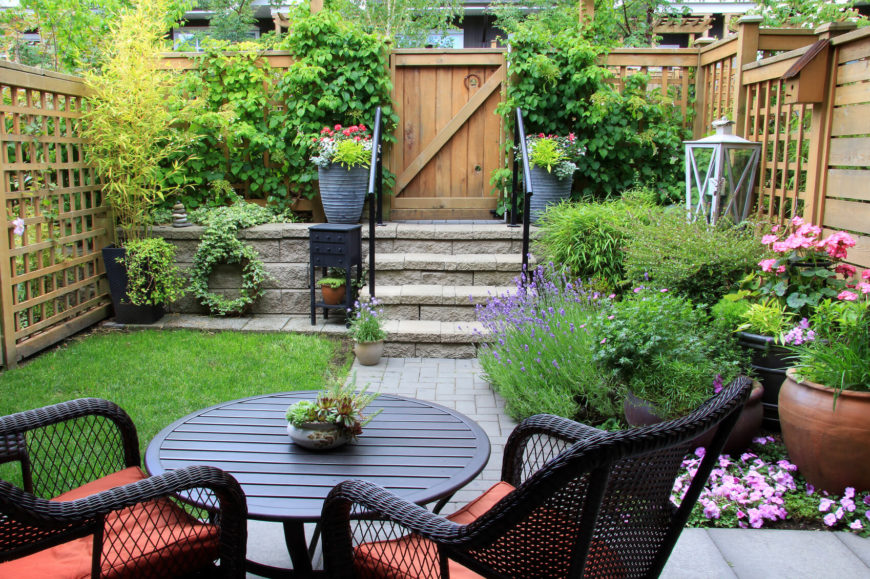 Thicker slats provide a more durable version of a typical lattice fence, seen here surrounding this quaint garden and patio.