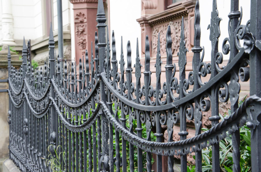 A stunning take on the wrought iron fence, with intricate details.