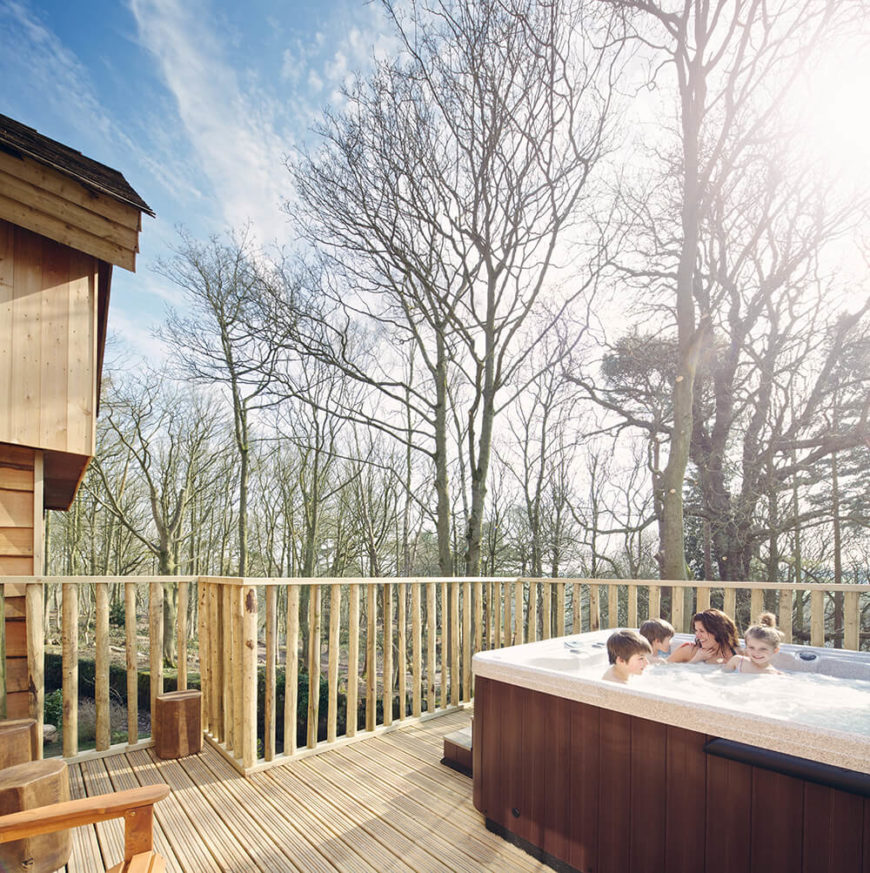 Each tree house features a private deck and patio area with a large hot tub with plenty of space for the whole family--up to 4 adults and 4 kids!