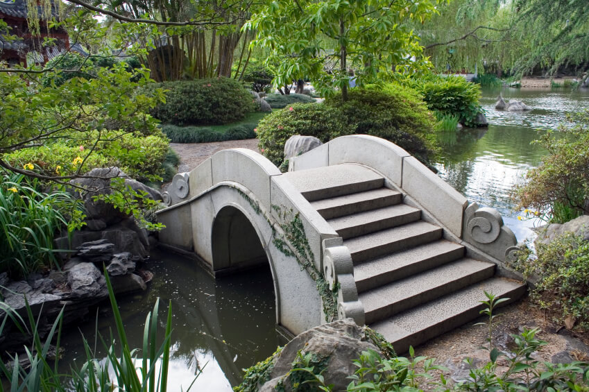 An Ornate Concrete Bridge Across A Wide But Shallow And Slow Moving Creek.  This
