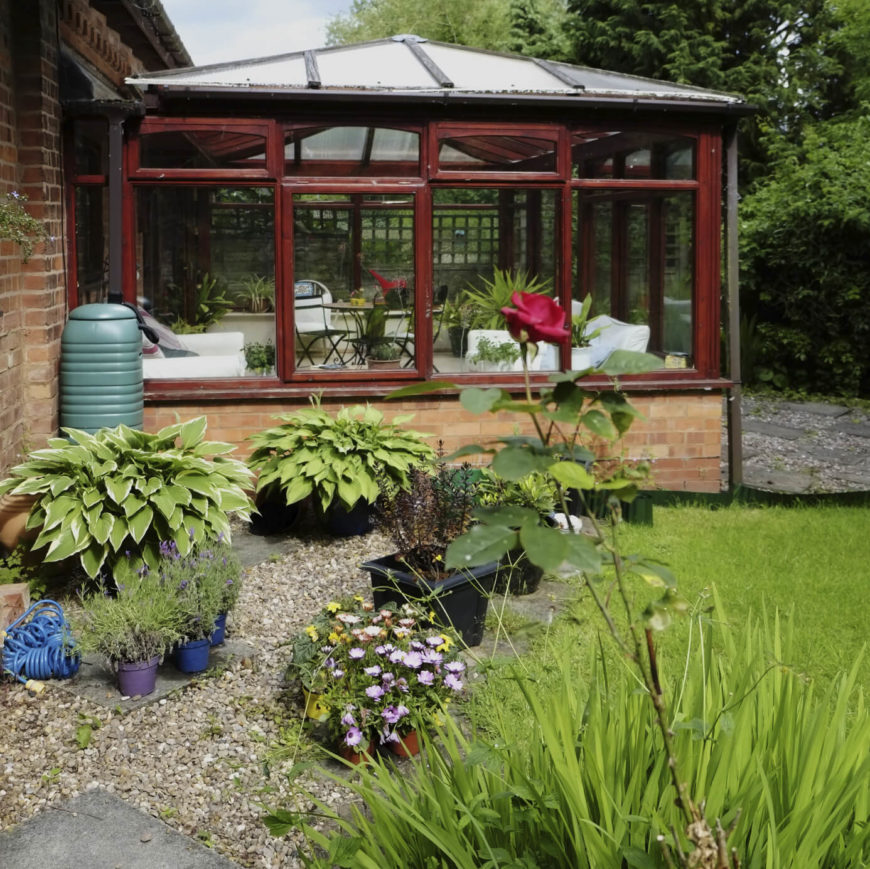 This Greenhouse Has Been Combined With A Sunroom For A Conservatory Feel.  The Building Is