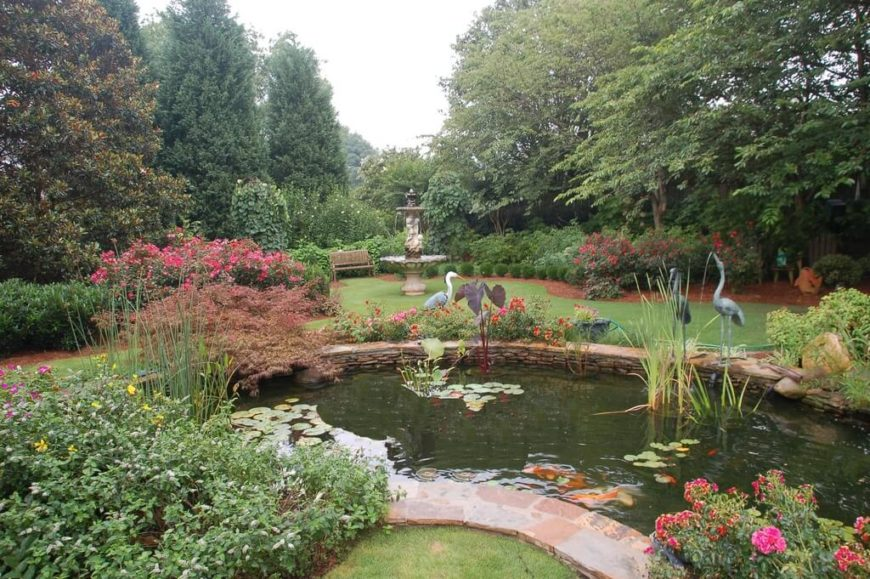 This enormous garden really takes advantage of the space available, adding a pool, egret statues, and a large fountain in the back corner with a bench from which to enjoy it all.