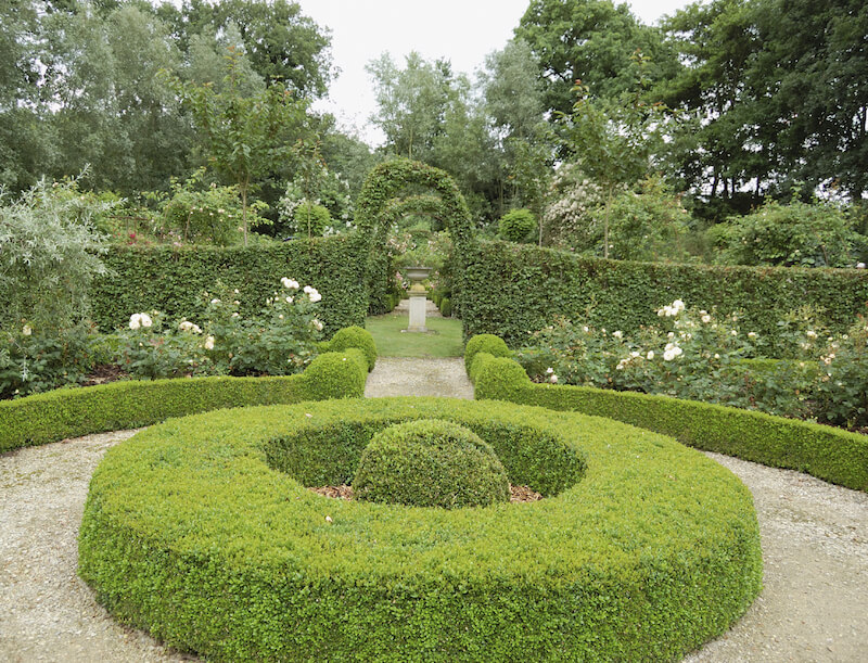 Even hedges can be transformed into topiary art. This garden has arches formed out of the hedge walls.