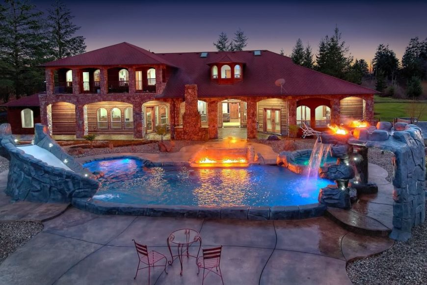 This is a small water park, complete with a faux stone slide, a waterfall with torches and a pathway, and even a hot tub and a small cove.