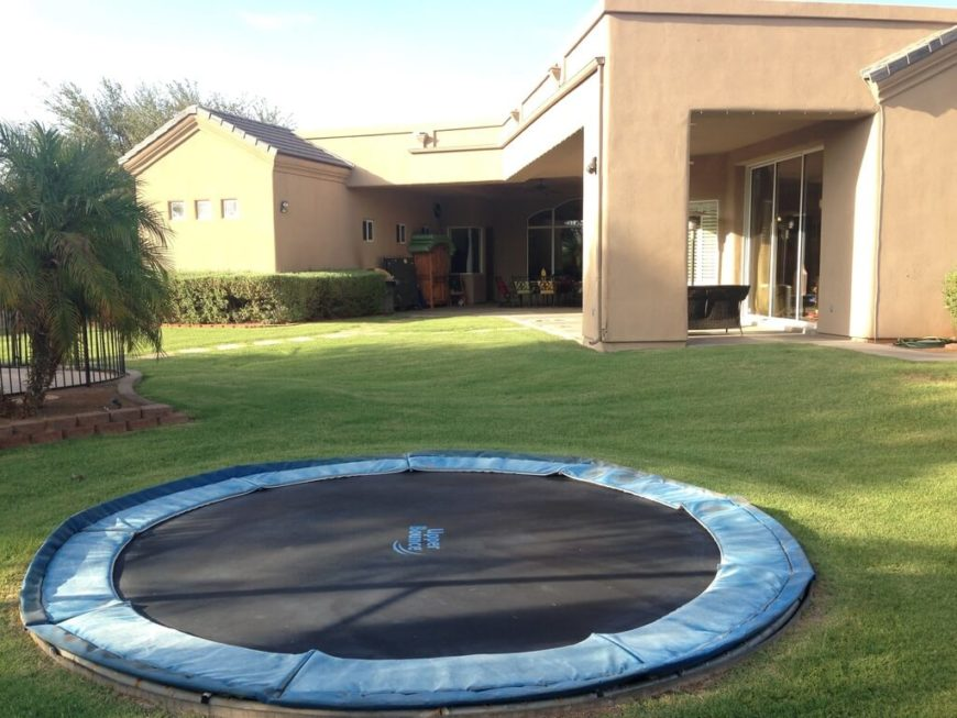 This trampoline has been placed into the ground to eliminate the possibility of a fall