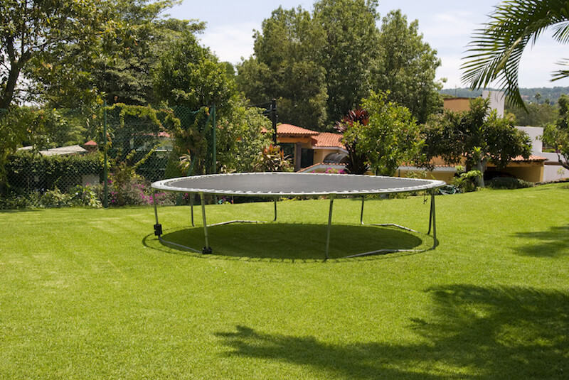 A simple above ground trampoline without netting. Older kids and adults may not need netting, but it's a great idea for younger kids.