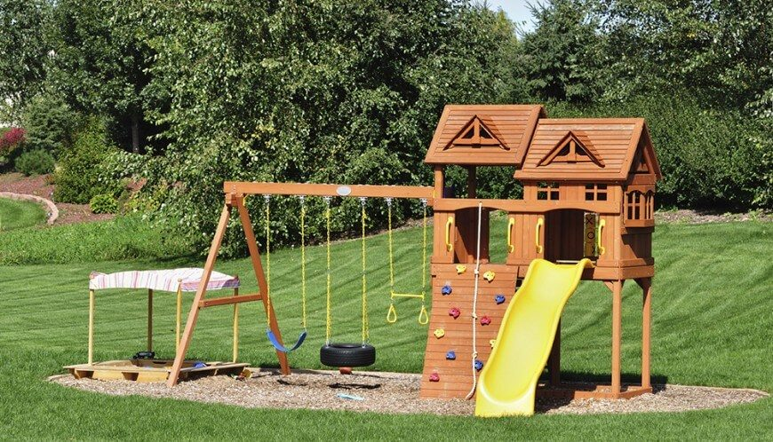 This playground has a little bit of everything, from a rock climbing wall, swings, a tic-tac-toe board, and even a sandbox.
