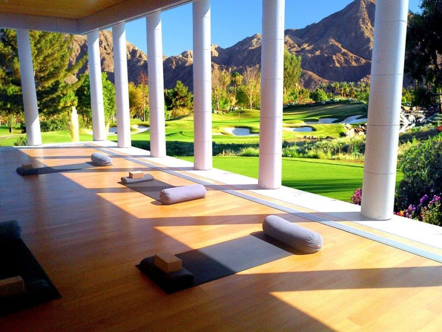 This yoga studio is located on a veranda overlooking a golf course. There's nothing like having the breeze on your skin while moving through yoga poses.