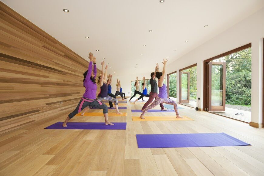 This custom yoga studio features plenty of doors that can be opened to let in a nice breeze.