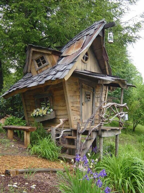 This is a ramshackle play house with crooked windows that give it the look of a fantasy home or maybe a witch's hut.