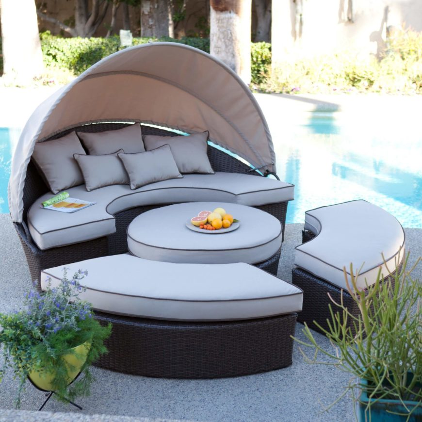 This incredible poolside set can be pushed together to form a lounge bed, or pushed apart to form a coffee table and three bench seats, one of which has a shade