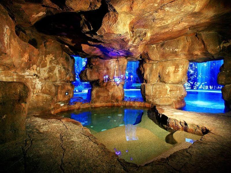 This hot tub is hidden away behind a waterfall in a luxury pool, and has a chandelier! Mom and dad can relax in a secluded cave while the kids hava a ball in the pool!