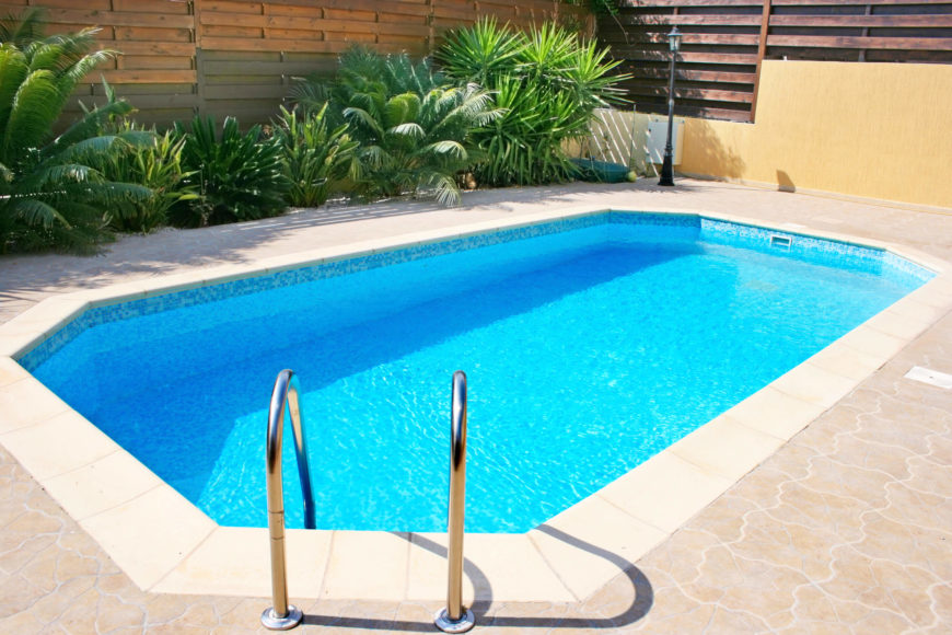 A nice simple small pool would work well in nearly any small space. the crystal clear water is a very attractive addition to a back yard patio.