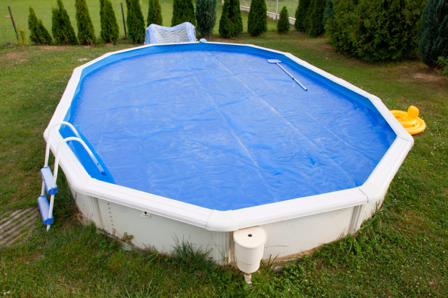 A standard winter cover is on this above ground pool. Th material is simple, and application is easy. For an above ground pool, without a dedicated heater, a solar cover like this is very useful to keep the water warm for swimming.