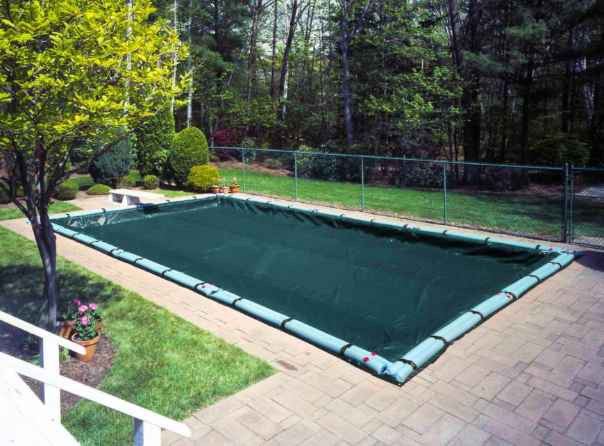Here's another example of a standard winter cover, set over a rectangular pool. The thin material is weighted around the edges for stability.