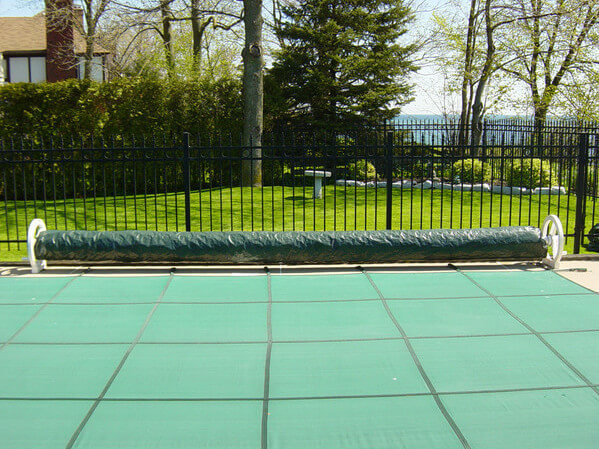 This pool has multiple covers, a security cover for longer term covering, as in the winter or long periods of non usage, and a solar cover for temporary covering.