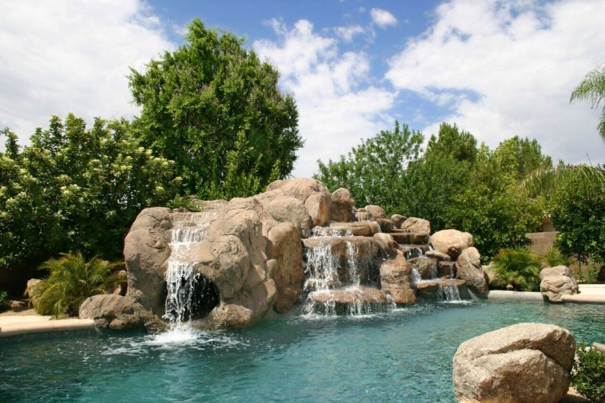 It may take a moment, but if you look, you can see the exit to an enclosed slide that exits right under a waterfall. This slide is a fun attraction that adds a large about of fun to a pool.