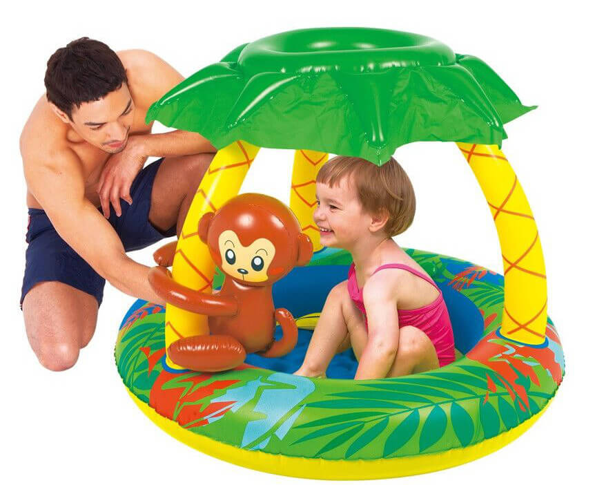 This pool for younger children is colorful and has a fun jungle theme, with a monkey and trees. It is fun and functional, and provides shade for kids as they play.