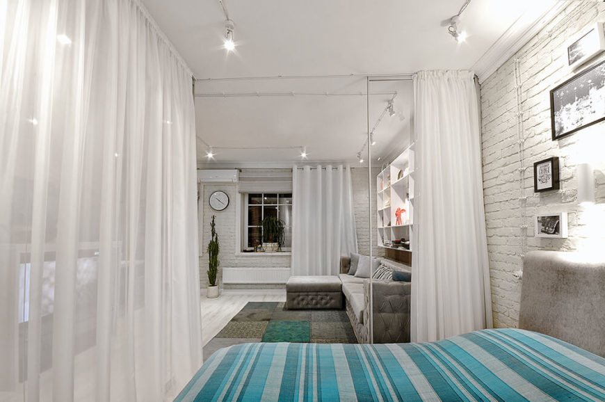 With the curtains pulled, much of the light is diffused, and the bedroom becomes a much more private area.