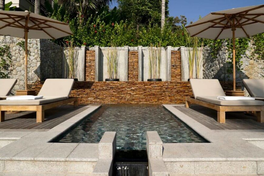 This is a perfect plunge pool, between two seating areas. The way this is set up, you can lounge back in your personal pool and still be sitting with friends
