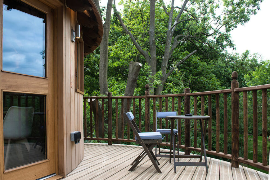 The treehouse's back deck has a small seating area for sipping morning coffee or enjoying a glass of wine as the evening winds down.