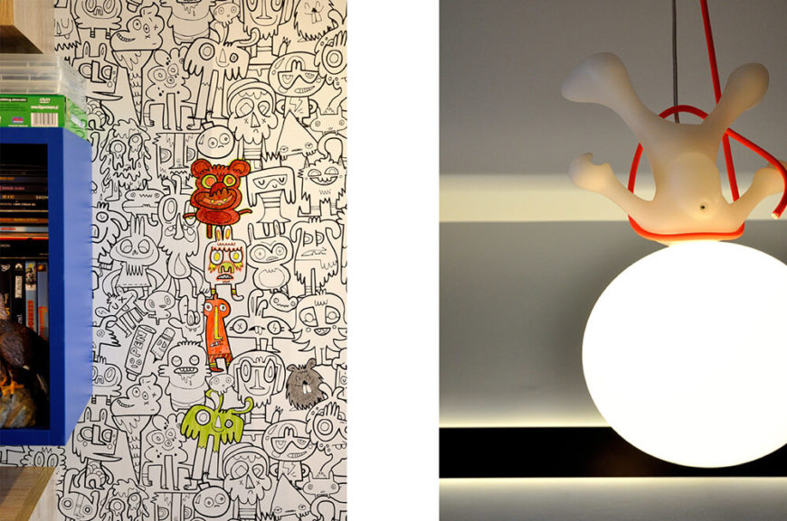 A closer look at the coloring book wallpaper and the room's quirky hanging person light fixture.