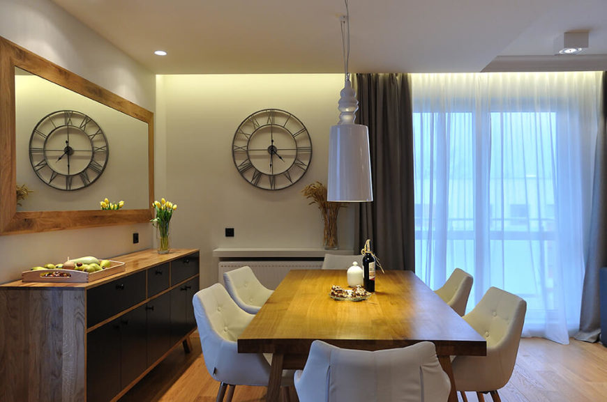 Across from the living room is the dining room, which has a flair for the modern and has lovely light wood throughout.