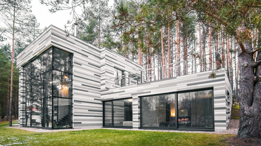 Incredible modern home with an exterior facade resembling birch bark.