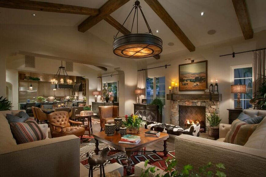 There are multiple different chairs in this living room. Leather is a great way to give a chair a rustic and rich texture and tone.