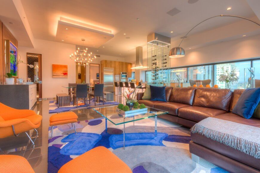 This Fun And Vibrant Room Uses Blue And Orange To Play Off Of Each Other To