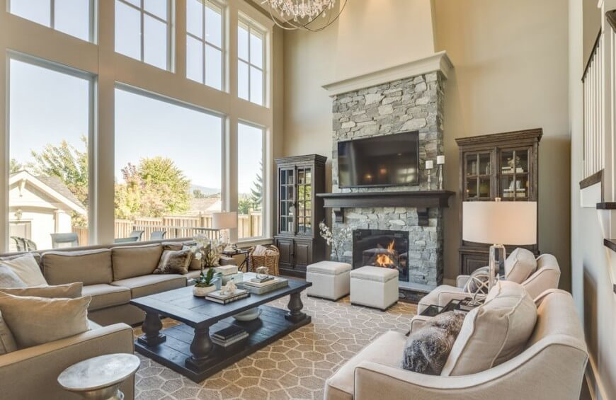 Marvelous Two Ottomans Sit Near A Fire In This Living Room. These Serve As Great Seats
