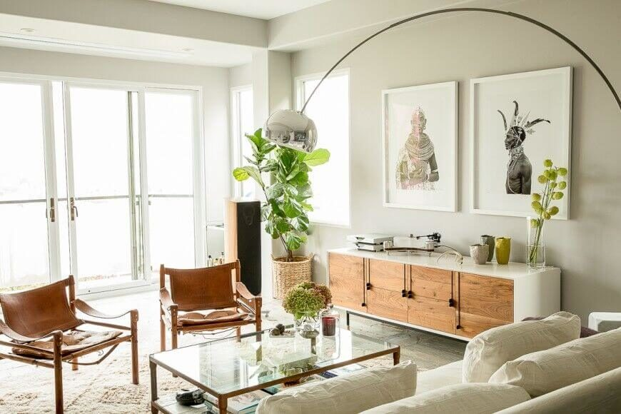 This living room has a nice, sleek, and interesting cabinet against the wall that has a top that can be used as a console table. There is also room under that table for keeping plenty of items.