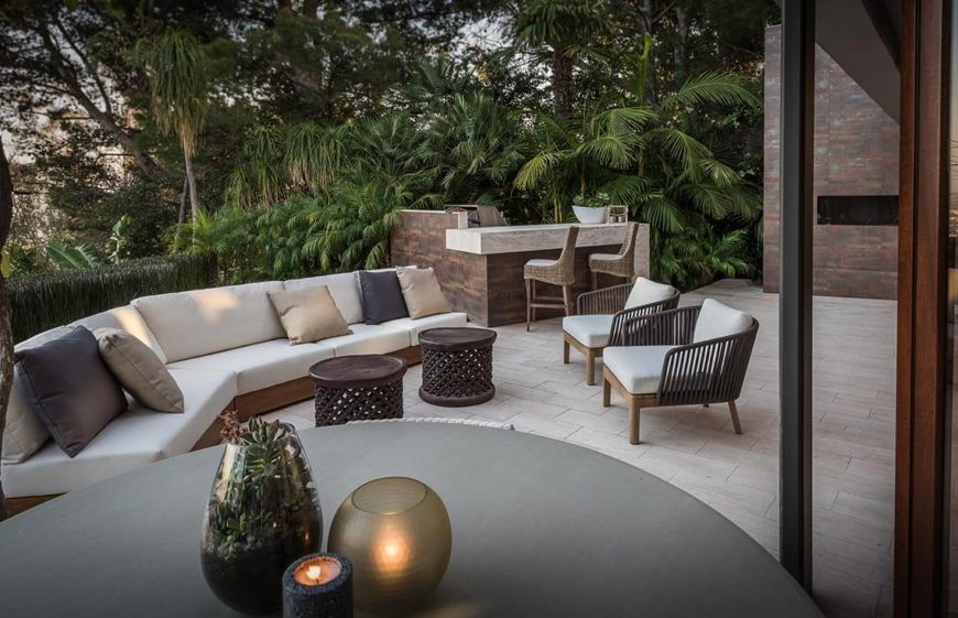 This outdoor space utilizes two of the three kinds of spaces good for patio staging. Off on the far end is a small eating area, perfect for a sunrise breakfast outside, and in the center is a nice neutral and relaxing space for hanging out with friends in the afternoon. This gives buyers an idea of the versatility and all the possibility that this patio area has.