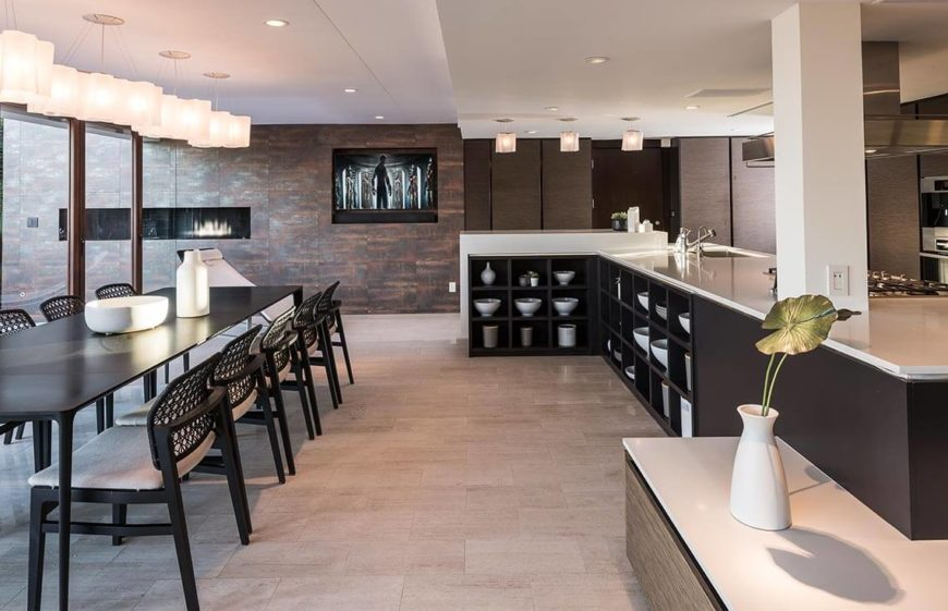 This angle shows the ample cupboard space again, as well as the well decorated counter tops. The light source can also be seen here, and the natural light gives this kitchen space, a light, and welcoming feel.