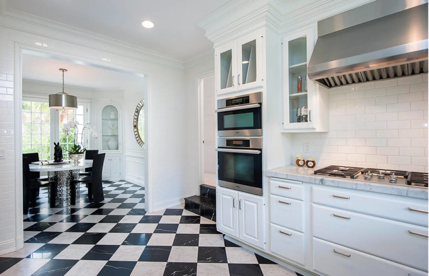 In this simple and elegant kitchen, we can see a mixture of natural light and bright artificial lights working to make a bright, clean and inviting space. The stainless steel appliances help cultivate the modern and updated look.