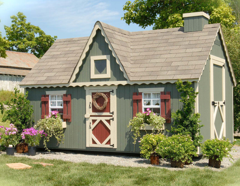 Green playhouse with dutch doors and cottage style windows. Dutch doors and cottage style windows make for an adorable country playhouse. This structure is also large enough that it could double as a storage shed when the children grow up.