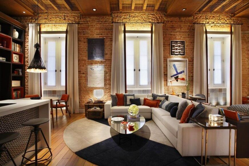 Here is a very interesting and pretty space, with exposed brick walls. You can see how these bricks make a room very warm, and when mixed with the right furnishings can be quite cozy.