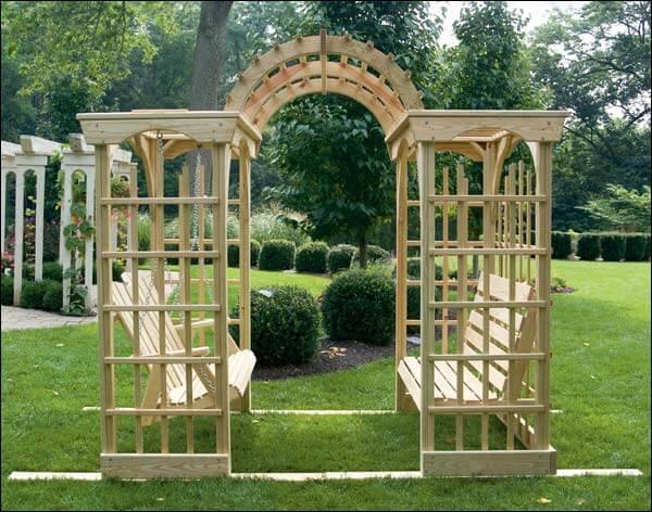 This freestanding arbor is wide and contains both a regular bench and a swinging bench. This is more of a solid structure, sort of a mix between a traditional arbor and a gazebo.