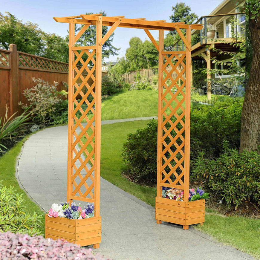 This simple arbor has small cedar flower boxes at the base of each side. The classic lattice is perfect for nearly any style of home.
