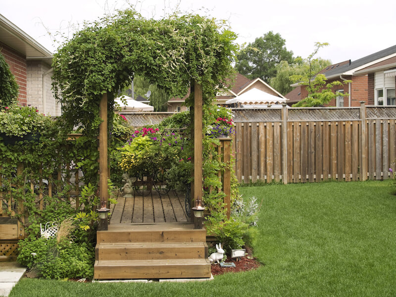 An Arbor Marks The Entrance To The Deck From The Backyard, And The Whole Of