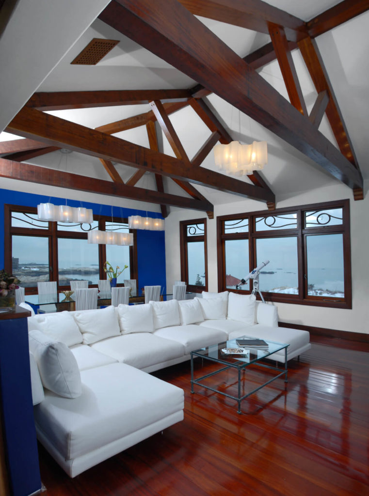 A Gorgeous Contemporary Living Room With Rich Dark Wooden Exposed Beams And  Incredible Views Through Craftsman