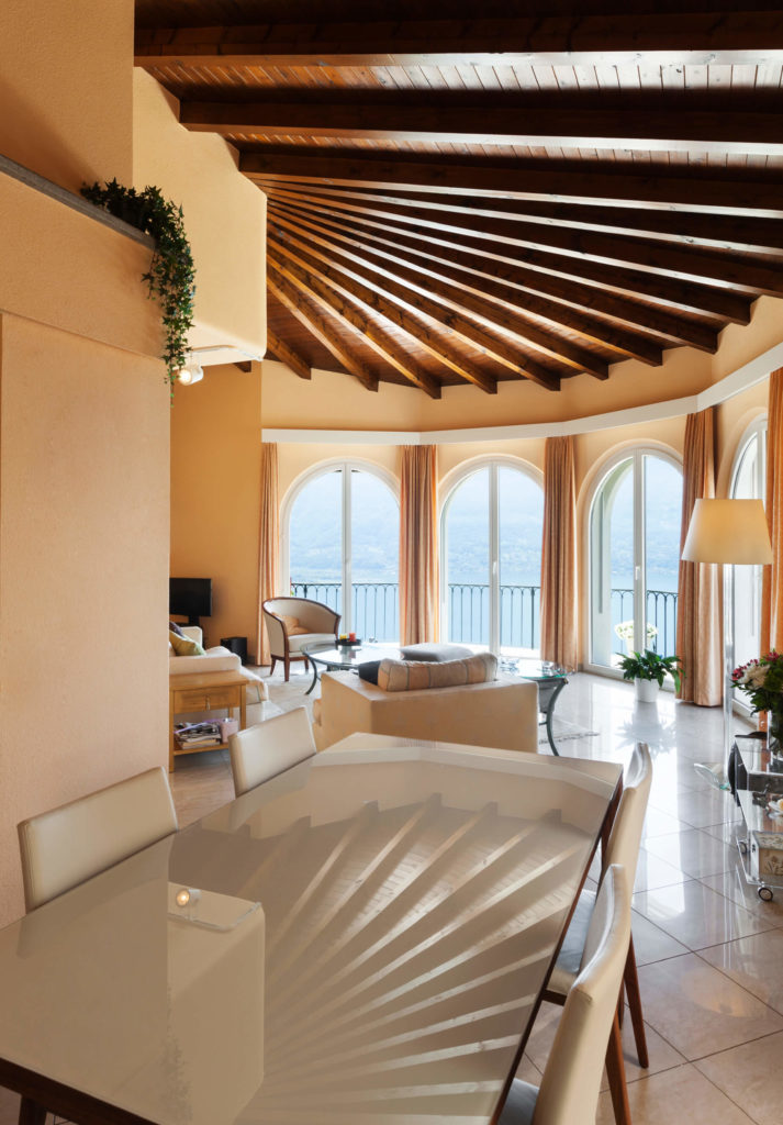 This Ceiling As An Interesting Curved Exposed Beam Design. The Room Seems  Much Larger With