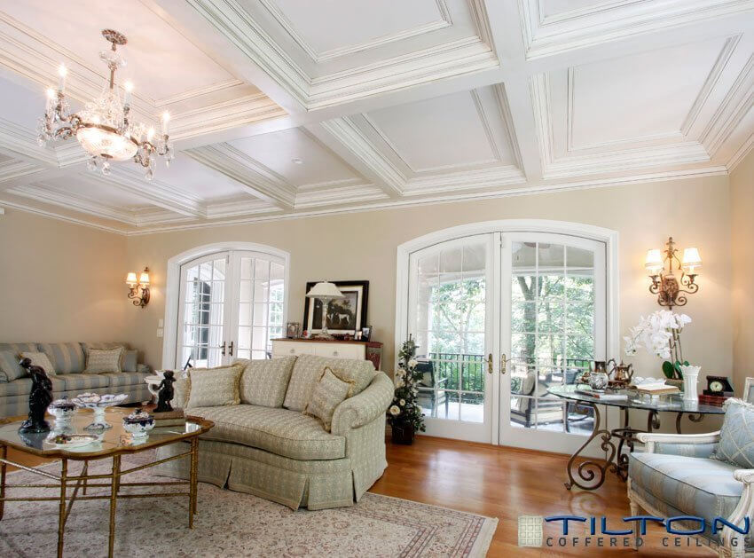 This living room has a nice example of a coffered ceiling, with a stunning chandelier over the main seating area. This design is sophisticated and brings an elegance to the design. This living room is designed perfectly to fit with this ceiling.