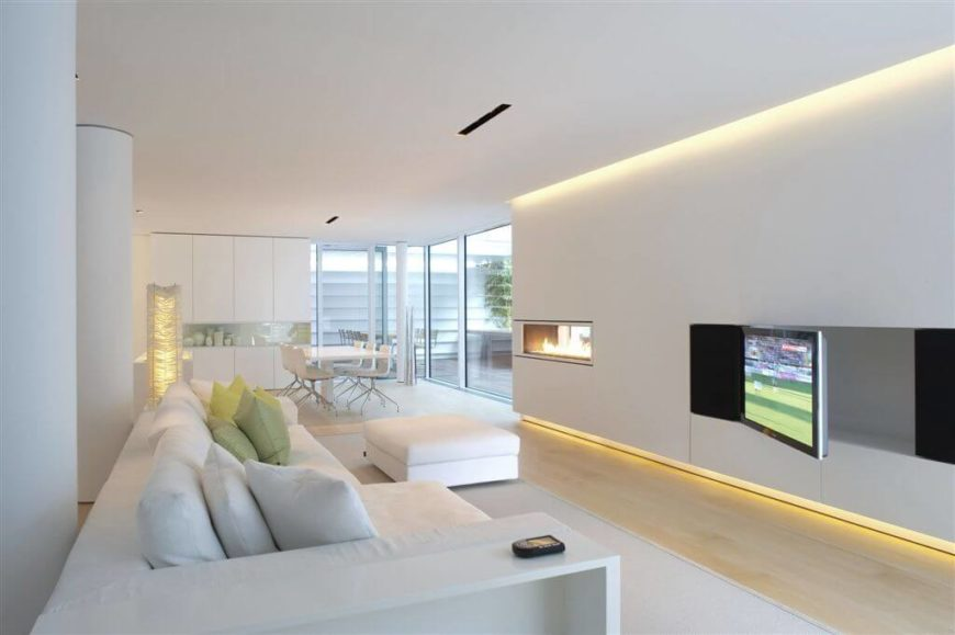 natural lighting in homes. this living room uses a bit recessed lighting but the majority of light is natural in homes