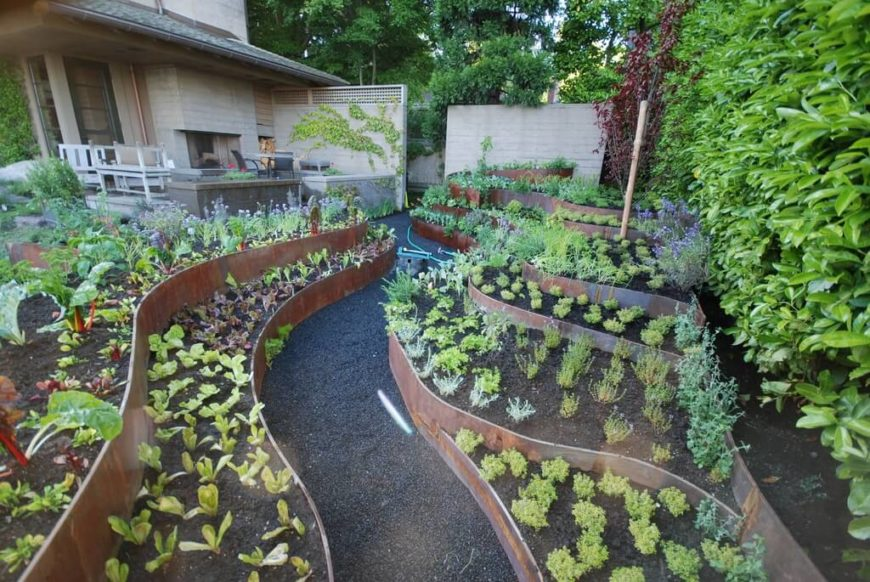 Backyard Gardening Ideas This vegetable garden has raised garden beds at different levels. The  multiple levels of this